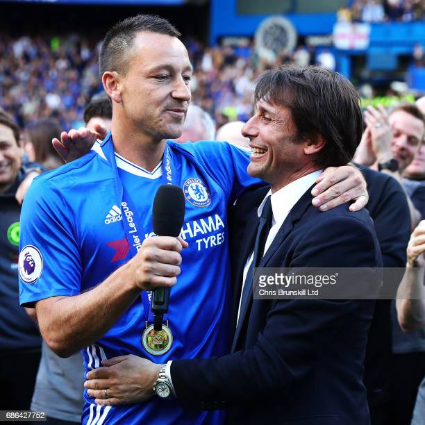 John Terry of Chelsea celebrates with manager Antonio Conte following the Premier League match between Chelsea and Sunderland at Stamford Bridge on...