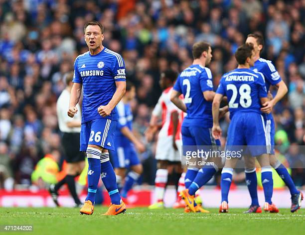John Terry of Chelsea celebrates with team mates after the Barclays Premier League match between Arsenal and Chelsea at Emirates Stadium on April 26...