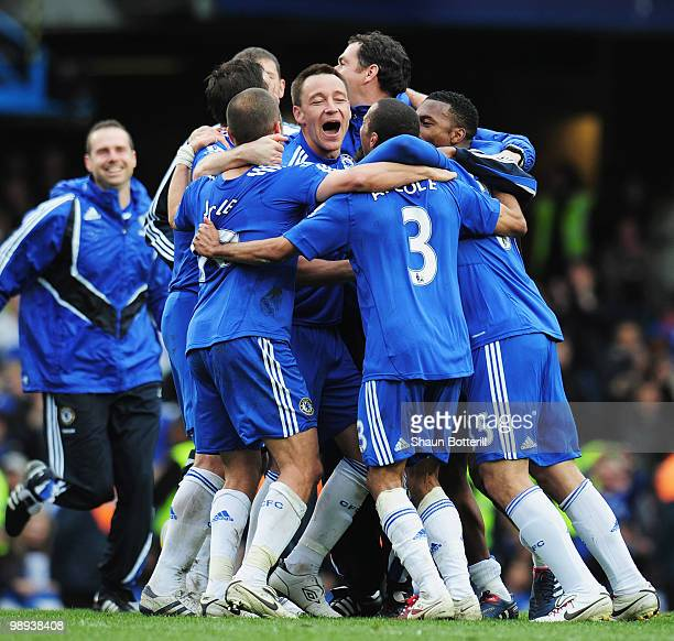 John Terry of Chelsea celebrates with team mates as they win the title after the Barclays Premier League match between Chelsea and Wigan Athletic at...