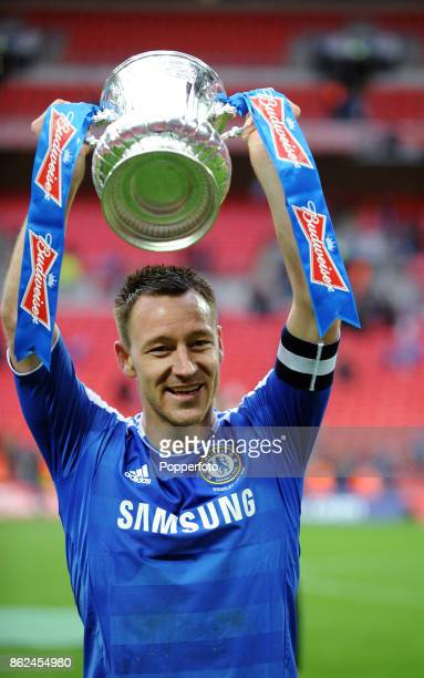 John Terry of Chelsea celebrates with the FA Cup after victory over Liverpool in the FA Cup Final at Wembley Stadium on May 05 2012 in London England