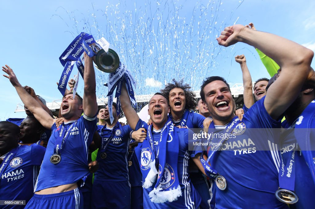 John Terry of Chelsea celebrates with the Premier League Trophy after the Premier League match between Chelsea and Sunderland at Stamford Bridge on May 21, 2017 in London, England.