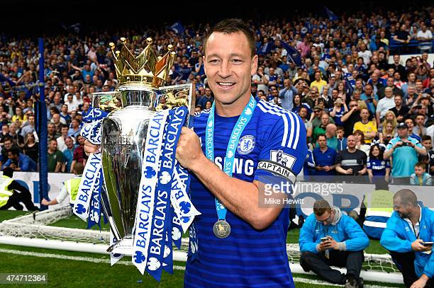 John Terry of Chelsea celebrates with the trophy after the Barclays Premier League match between Chelsea and Sunderland at Stamford Bridge on May 24...