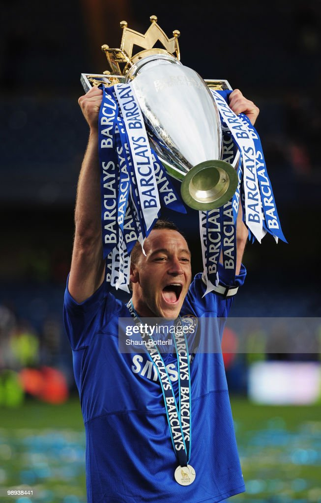 <a gi-track='captionPersonalityLinkClicked' href=/galleries/search?phrase=John+Terry&family=editorial&specificpeople=171535 ng-click='$event.stopPropagation()'>John Terry</a> of Chelsea celebrates with the trophy after the Barclays Premier League match between Chelsea and Wigan Athletic at Stamford Bridge on May 9, 2010 in London, England. Chelsea won 8-0 to win the title.