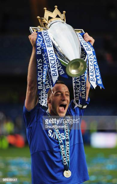 John Terry of Chelsea celebrates with the trophy after the Barclays Premier League match between Chelsea and Wigan Athletic at Stamford Bridge on May...