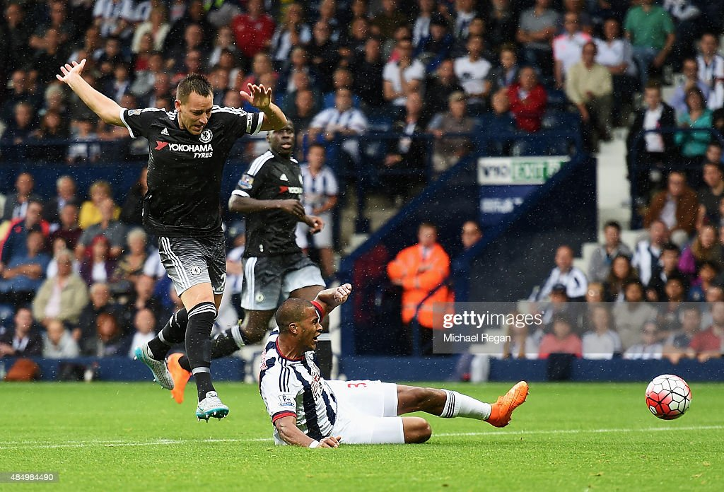 John Terry of Chelsea challenges Salomon Rondon of West Bromwich Albion leading to his red card during the Barclays Premier League match between West Bromwich Albion and Chelsea at The Hawthorns on August 23, 2015 in West Bromwich, England.