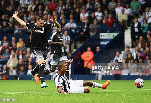 John Terry of Chelsea challenges Salomon Rondon of West Bromwich Albion leading to his red card during the Barclays Premier League match between West...