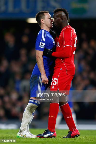 John Terry of Chelsea clashes with Mario Balotelli of Liverpool during the Capital One Cup SemiFinal second leg between Chelsea and Liverpool at...