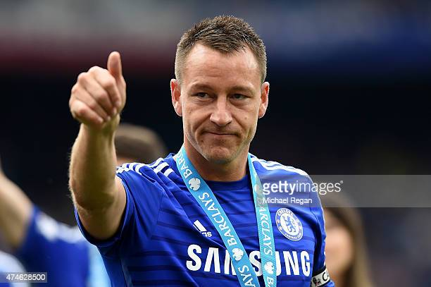 John Terry of Chelsea cleebrates winning the Premier League title after the Barclays Premier League match between Chelsea and Sunderland at Stamford...