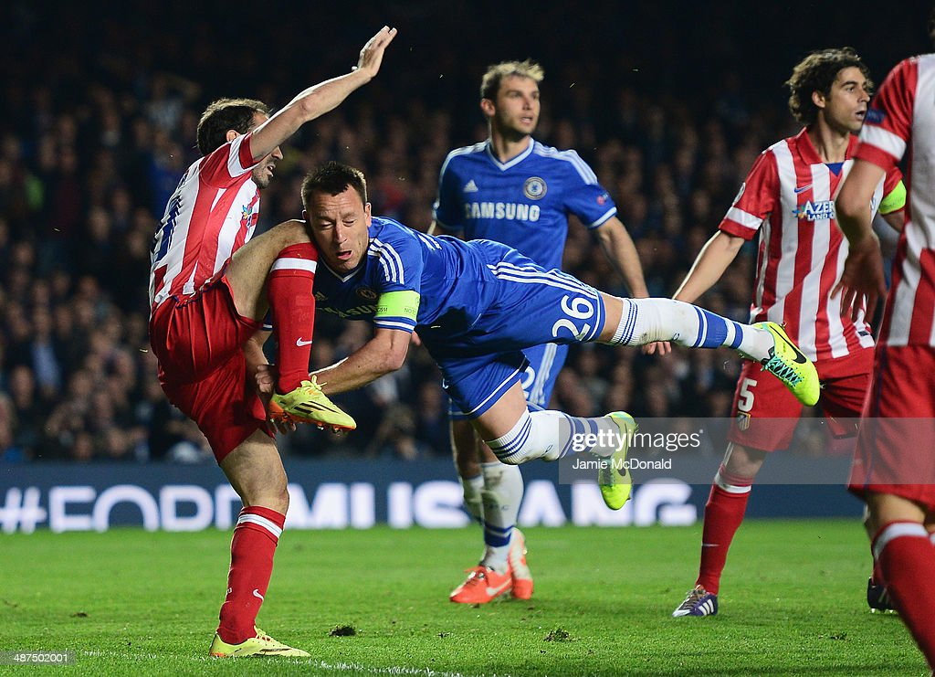 John Terry of Chelsea collides with Juanfran of Club Atletico de Madrid during the UEFA Champions League semi-final second leg match between Chelsea and Club Atletico de Madrid at Stamford Bridge on April 30, 2014 in London, England.