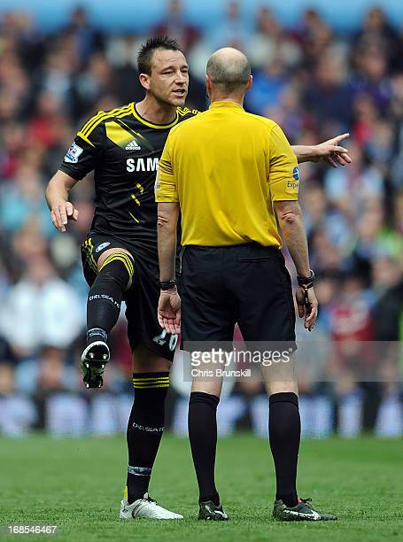 John Terry of Chelsea complains to referee Lee Mason after Ramires was sentoff during the Barclays Premier League match between Aston Villa and...