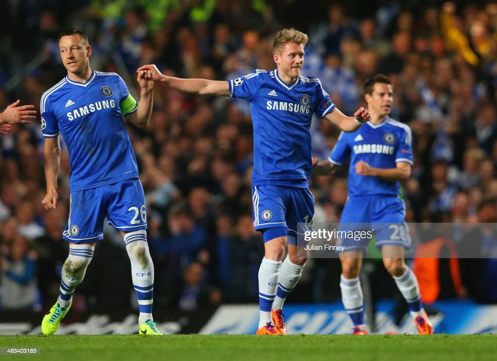 <a gi-track='captionPersonalityLinkClicked' href=/galleries/search?phrase=John+Terry&family=editorial&specificpeople=171535 ng-click='$event.stopPropagation()'>John Terry</a> of Chelsea congratulates Andre Schurrle of Chelsea on scoring their first goal during the UEFA Champions League Quarter Final second leg match between Chelsea and Paris Saint-Germain FC at Stamford Bridge on April 8, 2014 in London, England.