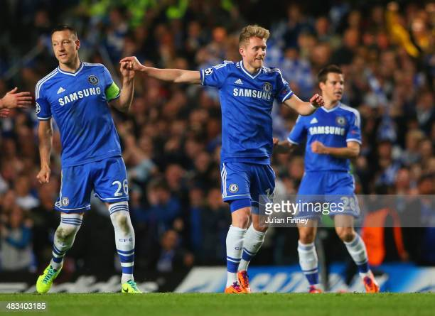 John Terry of Chelsea congratulates Andre Schurrle of Chelsea on scoring their first goal during the UEFA Champions League Quarter Final second leg...