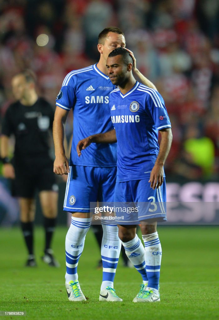 John Terry of Chelsea consoles Ashley Cole of Chelsea after defeat during the UEFA Super Cup between Bayern Muenchen and Chelsea at Stadion Eden on August 30, 2013 in Prague, Czech Republic.