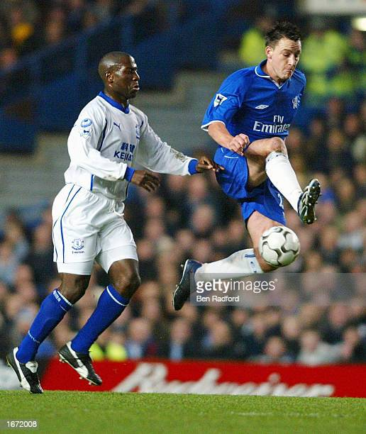 John Terry of Chelsea controls the ball as Kevin Campbell of Everton looks on during the Worthington Cup fourth round match between Chelsea and...