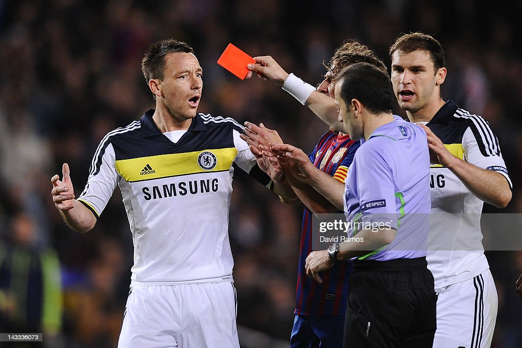 <a gi-track='captionPersonalityLinkClicked' href=/galleries/search?phrase=John+Terry&family=editorial&specificpeople=171535 ng-click='$event.stopPropagation()'>John Terry</a> of Chelsea FC (L) is shown a red card by referee Cuneyt Cakir during the UEFA Champions League Semi Final, second leg match between FC Barcelona and Chelsea FC at Camp Nou on April 24, 2012 in Barcelona, Spain.