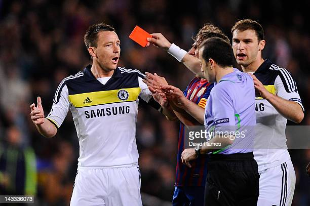 John Terry of Chelsea FC is shown a red card by referee Cuneyt Cakir during the UEFA Champions League Semi Final second leg match between FC...