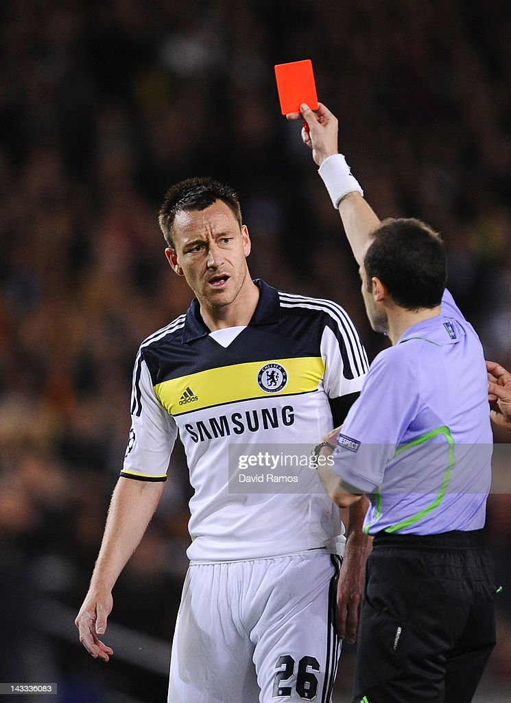 <a gi-track='captionPersonalityLinkClicked' href=/galleries/search?phrase=John+Terry&family=editorial&specificpeople=171535 ng-click='$event.stopPropagation()'>John Terry</a> of Chelsea FC (L) reacts as he is shown a red card by referee Cuneyt Cakir during the UEFA Champions League Semi Final, second leg match between FC Barcelona and Chelsea FC at Camp Nou on April 24, 2012 in Barcelona, Spain.