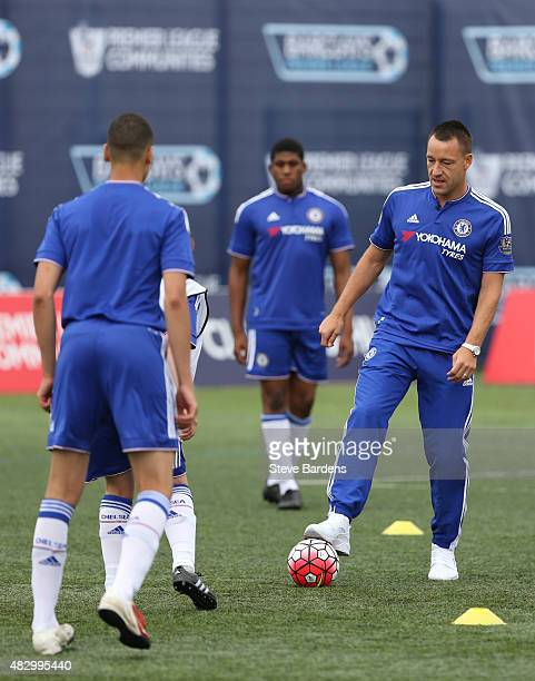 John Terry of Chelsea FC takes part in a training session with young Chelsea players during the official Premier League season launch media event at...