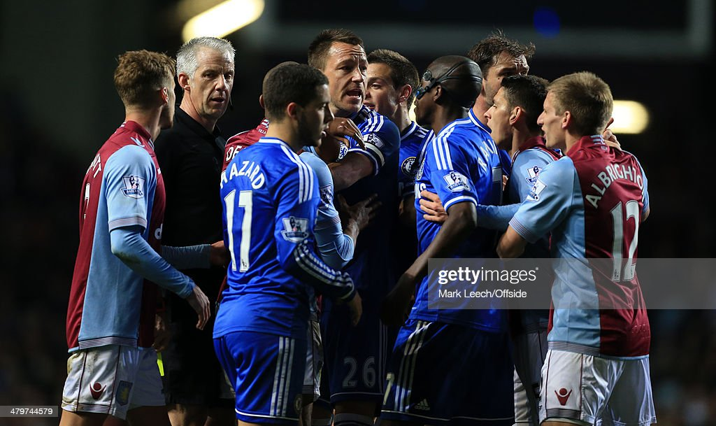 John Terry of Chelsea (C) finds himself in the thick of the action as players clash during the Barclays Premier League match between Aston Villa and Chelsea at Villa Park on March 15, 2014 in Birmingham, England.