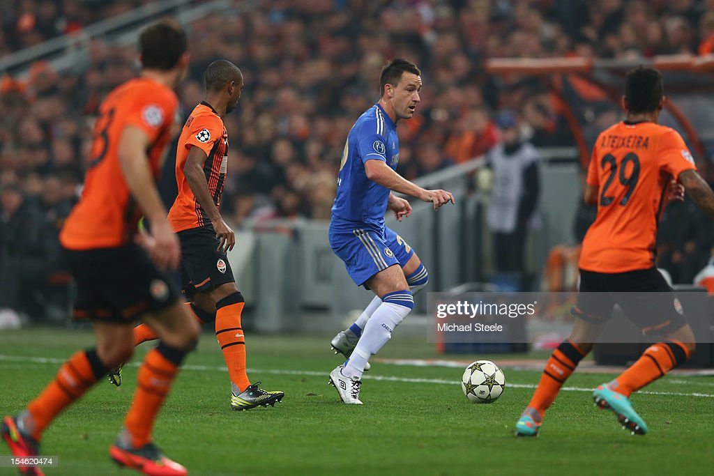 <a gi-track='captionPersonalityLinkClicked' href=/galleries/search?phrase=John+Terry&family=editorial&specificpeople=171535 ng-click='$event.stopPropagation()'>John Terry</a> (2R) of Chelsea finds himself surrounded during the UEFA Champions League Group E match between Shakhtar Donetsk and Chelsea at the Donbass Arena on October 23, 2012 in Donetsk, Ukraine.