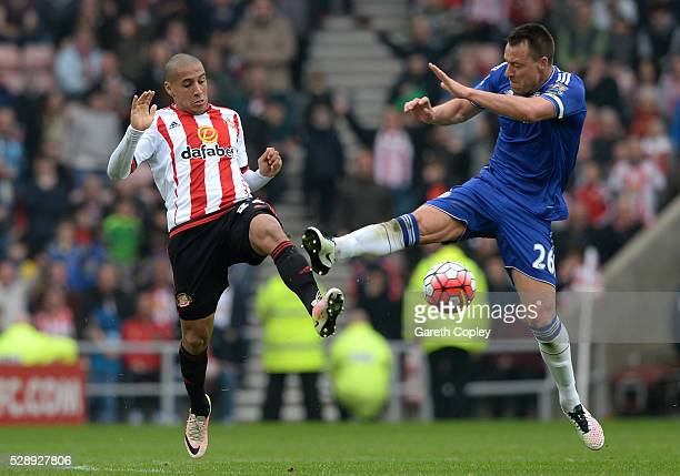 John Terry of Chelsea fouls Wahbi Khazri of Sunderland resutling in the second yellow card during the Barclays Premier League match between...