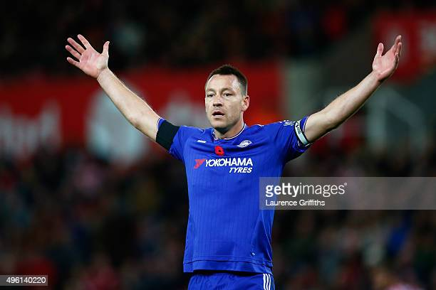 John Terry of Chelsea gestures during the Barclays Premier League match between Stoke City and Chelsea at Britannia Stadium on November 7 2015 in...