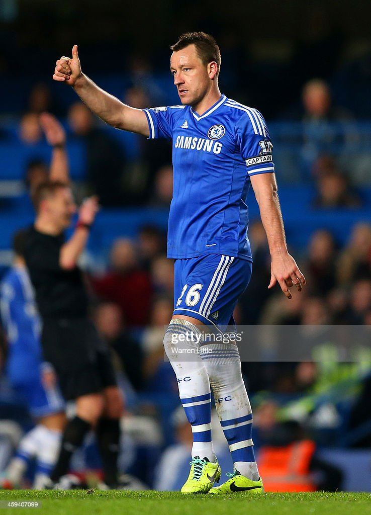 John Terry of Chelsea gives a thumbs up to the lines man during the Barclays Premier League match between Chelsea and Swansea City at Stamford Bridge on December 26, 2013 in London, England.