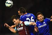 John Terry of Chelsea heads the ball clear during the Barclays Premier League match between Burnley and Chelsea at Turf Moor on August 18 2014 in...