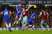 John Terry of Chelsea heads the ball during the Barclays Premier League match between Chelsea and West Ham United at Stamford Bridge on January 29...