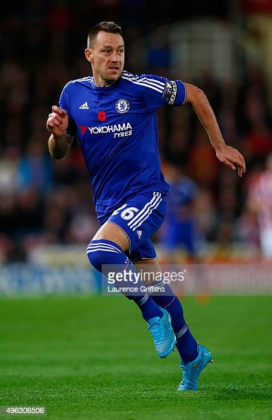 John Terry of Chelsea in action during the Barclays Premier League match between Stoke City and Chelsea at Britannia Stadium on November 7 2015 in...