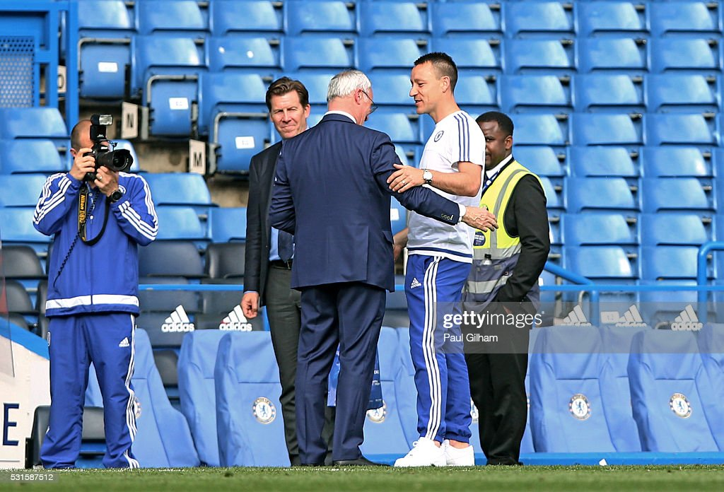 John Terry of Chelsea in conversation with Claudio Ranieri Manager of Leicester City during the Barclays Premier League match between Chelsea and Leicester City at Stamford Bridge on May 15, 2016 in London, England.