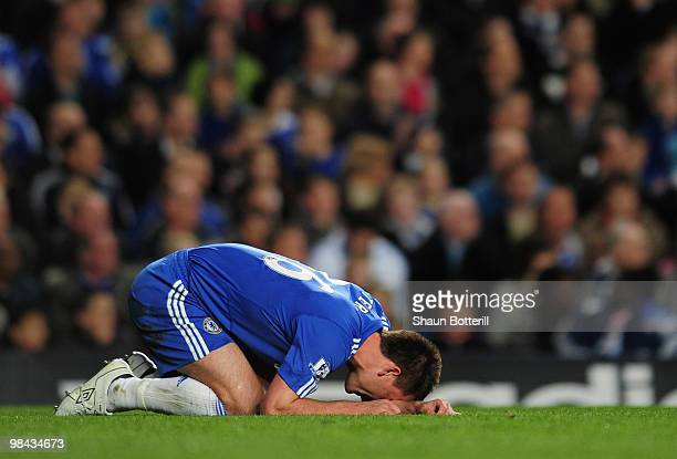 John Terry of Chelsea is injured during the Barclays Premier League match between Chelsea and Bolton Wanderers at Stamford Bridge on April 13 2010 in...