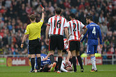 John Terry of Chelsea is shown a red card by referee Mike Jones after fouling on Wahbi Khazri of Sunderland during the Barclays Premier League match...