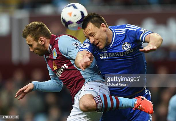 John Terry of Chelsea jumps with Andreas Weimann of Aston Villa during the Barclays Premier League match between Aston Villa and Chelsea at Villa...