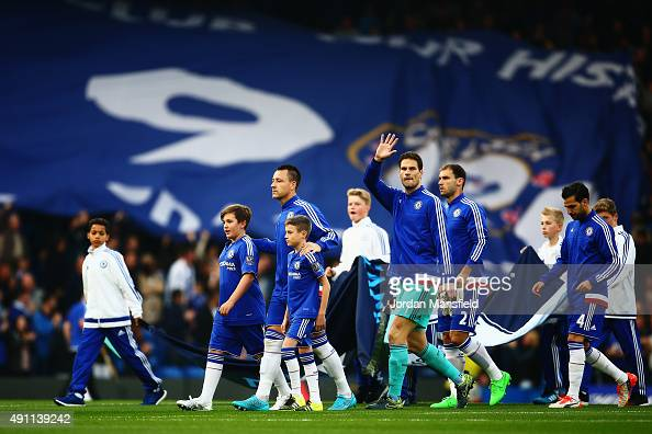 John Terry of Chelsea leads out his side with match mascots before the Barclays Premier League match between Chelsea and Southampton at Stamford...