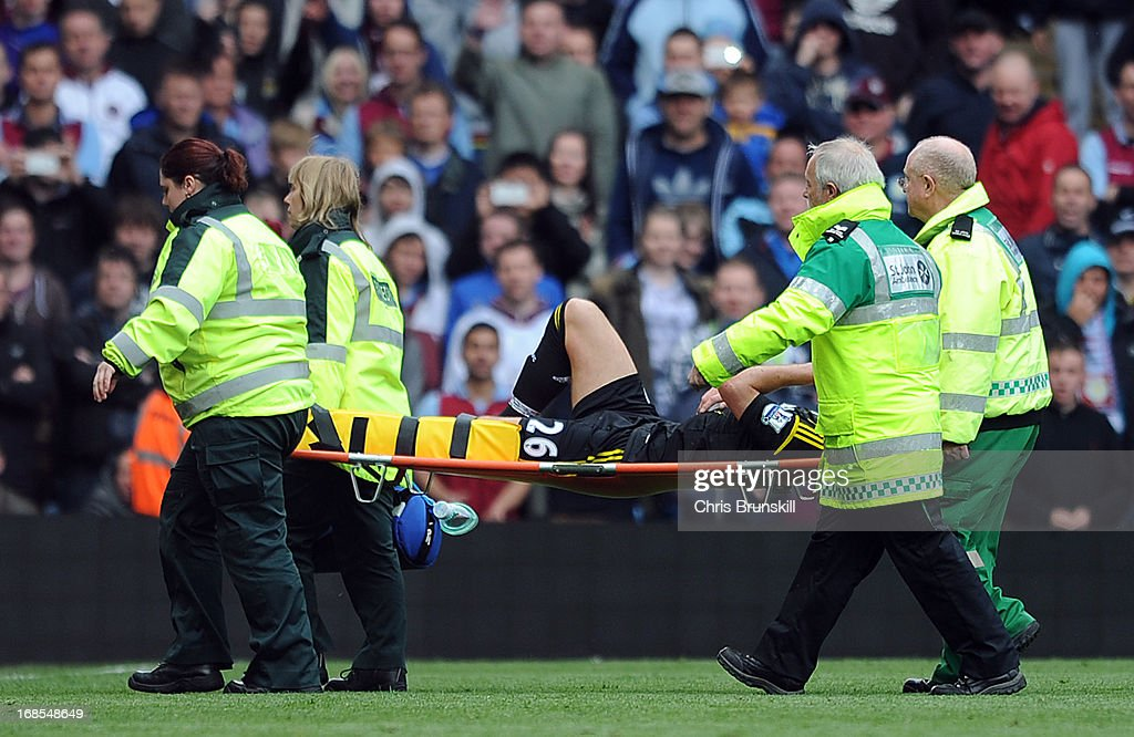 John Terry of Chelsea leaves the field on a stretcher during the Barclays Premier League match between Aston Villa and Chelsea at Villa Park on May 11, 2013 in Birmingham, England.