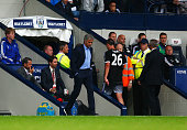 John Terry of Chelsea leaves the pitch after being sent off as Jose Mourinho manager of Chelsea looks on during the Barclays Premier League match...