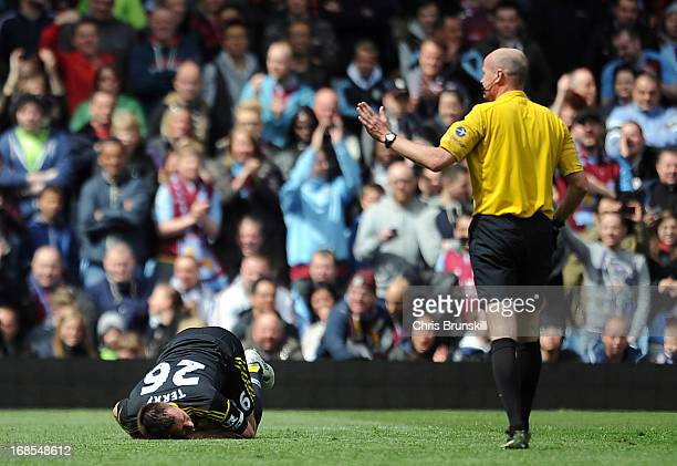 John Terry of Chelsea lies injured during the Barclays Premier League match between Aston Villa and Chelsea at Villa Park on May 11 2013 in...