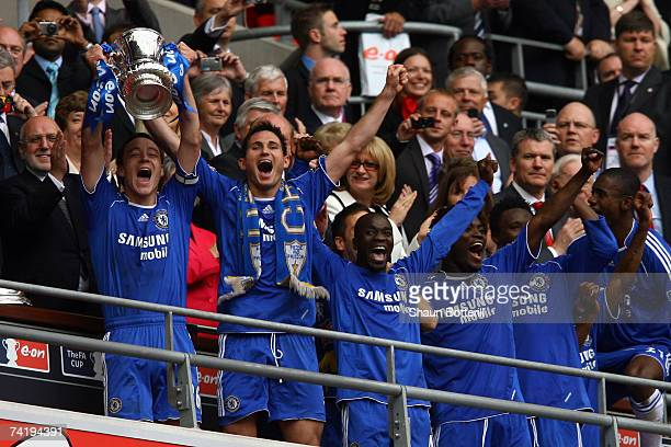 John Terry of Chelsea lifts the FA Cup trophy following the FA Cup Final match sponsored by EON between Manchester United and Chelsea at Wembley...