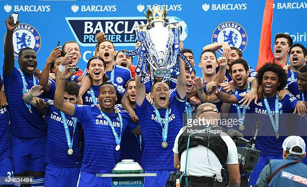 John Terry of Chelsea lifts the trophy after the Barclays Premier League match between Chelsea and Sunderland at Stamford Bridge on May 24 2015 in...