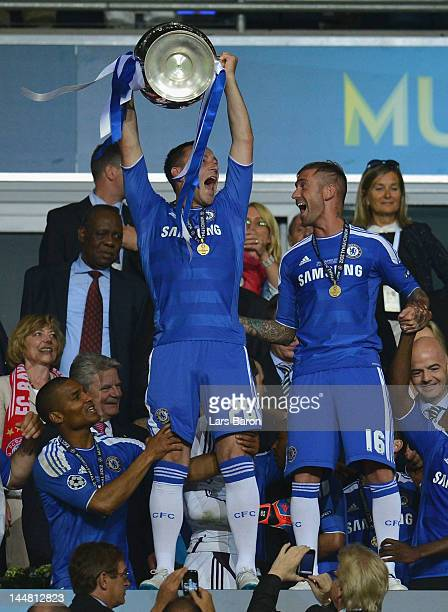 John Terry of Chelsea lifts the trophy after their victory in the UEFA Champions League Final between FC Bayern Muenchen and Chelsea at the Fussball...