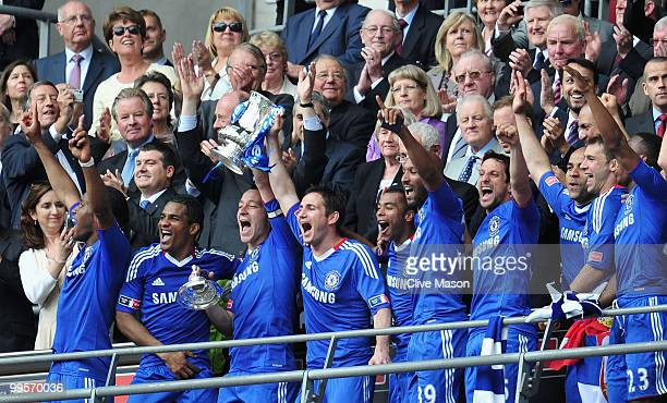 John Terry of Chelsea lifts the trophy with his team mates following their victory at the end of the FA Cup sponsored by EON Final match between...