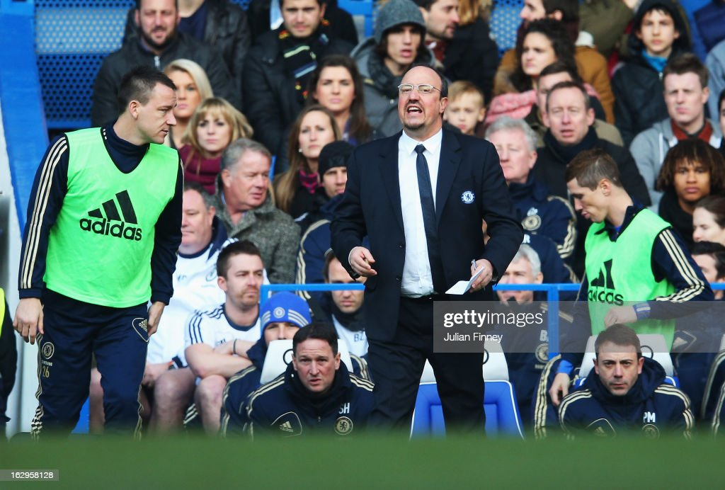 <a gi-track='captionPersonalityLinkClicked' href=/galleries/search?phrase=John+Terry&family=editorial&specificpeople=171535 ng-click='$event.stopPropagation()'>John Terry</a> (L) of Chelsea looks at Rafael Benitez, interim manager of Chelsea as <a gi-track='captionPersonalityLinkClicked' href=/galleries/search?phrase=Fernando+Torres&family=editorial&specificpeople=194755 ng-click='$event.stopPropagation()'>Fernando Torres</a> (R) begins to warm up during the Barclays Premier League match between Chelsea and West Bromwich Albion at Stamford Bridge on March 2, 2013 in London, England.