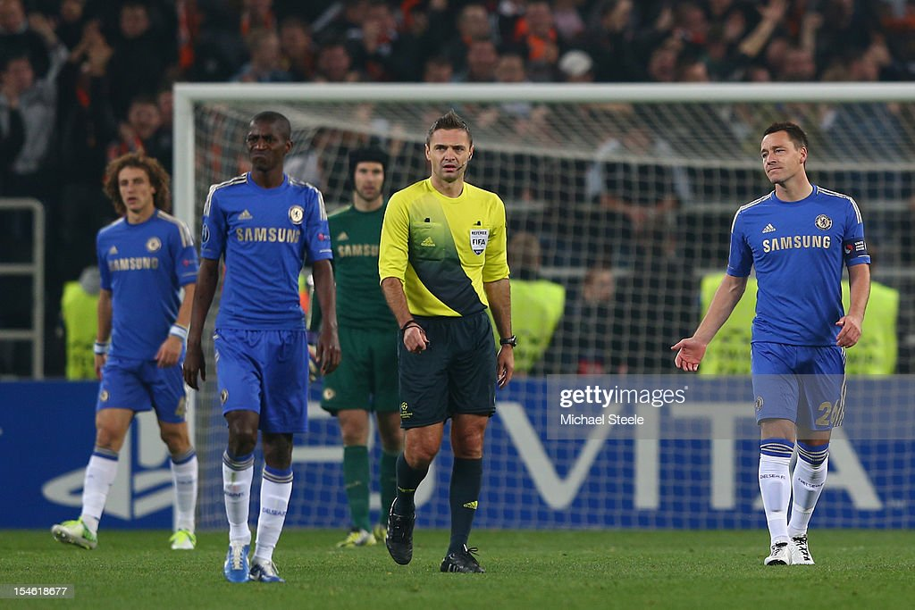 <a gi-track='captionPersonalityLinkClicked' href=/galleries/search?phrase=John+Terry&family=editorial&specificpeople=171535 ng-click='$event.stopPropagation()'>John Terry</a> (R)of Chelsea looks dejected after his side concedes a second goal during the UEFA Champions League Group E match between Shakhtar Donetsk and Chelsea at the Donbass Arena on October 23, 2012 in Donetsk, Ukraine.