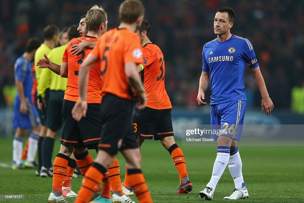 John Terry (R)of Chelsea looks dejected after his sides 1-2 defeat during the UEFA Champions League Group E match between Shakhtar Donetsk and Chelsea at the Donbass Arena on October 23, 2012 in Donetsk, Ukraine.