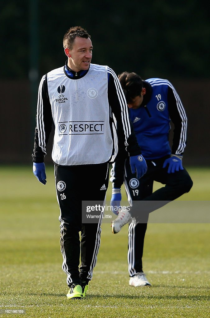 John Terry of Chelsea looks on during a training session at Cobham training ground on February 20, 2013 in Cobham, England.