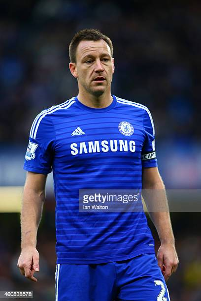 John Terry of Chelsea looks on during the Barclays Premier League match between Chelsea and West Ham United at Stamford Bridge on December 26 2014 in...