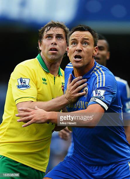 John Terry of Chelsea marks Grant Holt of Norwich City during the Barclays Premier League match between Chelsea and Norwich City at Stamford Bridge...