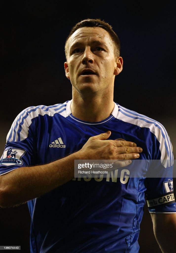 <a gi-track='captionPersonalityLinkClicked' href=/galleries/search?phrase=John+Terry&family=editorial&specificpeople=171535 ng-click='$event.stopPropagation()'>John Terry</a> of Chelsea pats the Chelsea badge after the Barclays Premier League match between Tottenham Hotspur and Chelsea at White Hart Lane on December 22, 2011 in London, England.