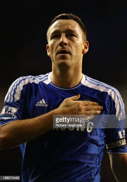 John Terry of Chelsea pats the Chelsea badge after the Barclays Premier League match between Tottenham Hotspur and Chelsea at White Hart Lane on...